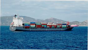Merchant vessels and cargo container ships entering the port royalty free stock photography