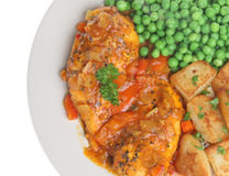 Piri-Piri Chicken Breasts. Marinated chicken in a spicy tomato sauce with sauteed potatoes and peas Stock Image