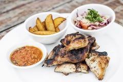 Piri piri portuguese roast chicken with jindungo spicy sauce mea Stock Photography