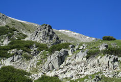 Pirin mountains in Bulgaria, gray rock summit during the sunny day with clear blue sky Royalty Free Stock Photography