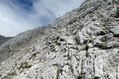 Pirin mountains in Bulgaria, gray rock summit during the sunny day with clear blue sky Stock Photo