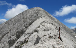 Pirin mountains in Bulgaria, gray rock summit during the sunny day with clear blue sky Stock Photos