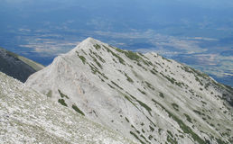 Pirin mountains in Bulgaria, gray rock summit during the sunny day with clear blue sky Royalty Free Stock Image