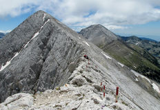 Pirin mountains in Bulgaria, gray rock summit during the sunny day with clear blue sky. Pirin mountains in Bulgaria, gray and white rock summit during the sunny Stock Image