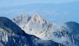 Pirin mountains in Bulgaria, gray rock summit during the sunny day with clear blue sky Stock Image
