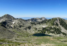 Pirin mountains in Bulgaria, gray rock summit during the sunny day with clear blue sky Stock Photography