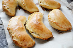 Pirogi or pierogi on baking tray, close up Stock Photo