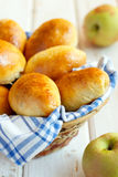 Pirogies pasties. On white wooden background in the basket Stock Photos