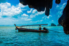 Pirogue in khao phing kan. Khao phing kan is famous with the name of james bond island Stock Images