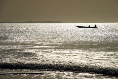 Pirogue silhouette. Cap Skirring, Senegal Royalty Free Stock Photography