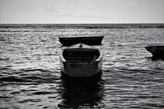 A seascape of a canoe stock photos