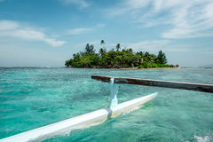 Pirogue on the way to paradise tropical atoll in Moorea Island l Stock Image