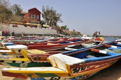 Pirogues on goree island senegal,. Amazing landscape with traditional senegalese pirogues on Goree island. Gorée is famous as a destination for people Royalty Free Stock Photos