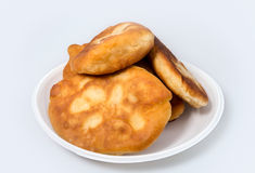 Pirojki. Traditional delicious Russian patty. With potatoes and meat Royalty Free Stock Photography