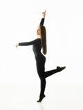 Pirouette. Graceful ballerina dancing in studio, posing on white background Stock Image