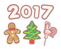 Piruleta del hombre de pan de jengibre, del árbol de navidad y del gallo Imágenes de archivo libres de regalías