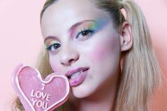 Piruleta del maquillaje y del corazón del arco iris Foto de archivo
