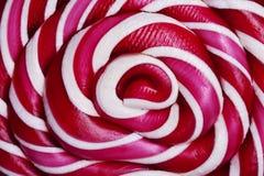 Piruleta espiral grande roja y blanca Imagen de archivo