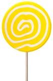 Piruleta redonda con remolinos amarillos y del blanco Fotografía de archivo libre de regalías