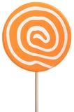 Piruleta redonda con remolinos anaranjados y del blanco Fotos de archivo libres de regalías