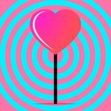 Piruleta rosada bajo la forma de corazón Fotografía de archivo