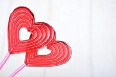 Piruletas para las tarjetas del día de San Valentín Imágenes de archivo libres de regalías