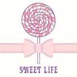 Pirulito cor-de-rosa com fita Fotografia de Stock Royalty Free