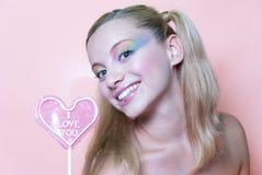 Pirulito da composição e do coração do arco-íris Fotos de Stock