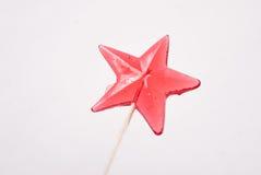 Pirulito em uma forma da estrela no fundo branco, fotografia de stock