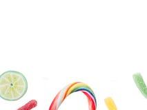 Pirulitos e doces isolados no branco Imagens de Stock