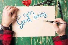 Pisać dzień dobry notatce odgórnym widoku Zdjęcie Stock