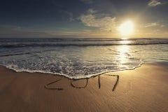 2017 pisać na piaskowatej plaży Obraz Stock