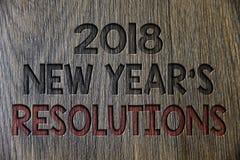 Pisać nutowemu seansowi 2018 nowy rok 'S postanowienia Biznesowa fotografia pokazuje listę cele lub cele być dokonującym Drewnian Obrazy Royalty Free