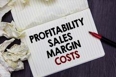Pisać nutowych pokazuje dochodowość sprzedaży marginesu kosztach Biznesowa fotografia pokazuje Biznesowych dochodów dochody Budże obraz royalty free