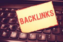 Pisać nutowym pokazuje Backlinks Biznesowa fotografia pokazuje przybywającego hyperlink od jeden strony internetowej inna duża st obrazy stock