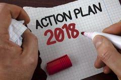 Pisać nutowym pokazuje planie działania 2018 Biznesowa fotografia pokazuje plany celuje aktywności życia celów ulepszenia rozwoju Fotografia Stock