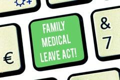 Pisać nutowym pokazuje Rodzinnym Medycznym urlopu akcie Biznesowa fotografia pokazuje FMLA prawo pracy nakrywkowych pracowników i obraz stock