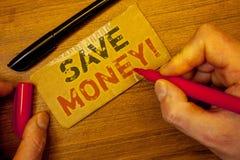 Pisać nutowym seansie Save pieniądze Motywacyjny wezwanie Biznesowe fotografie Robią funduszowi od earningsMan creati pokazywać Z Fotografia Stock