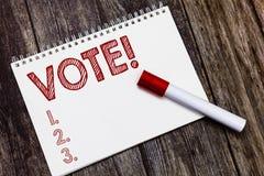 Pisać nutowym seansu głosowaniu Biznesowa fotografia pokazuje formalnego przejawu wybór między dwa lub więcej kandydat akcjami obraz stock