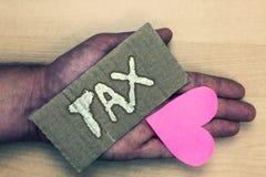 Pisać nutowym seansu podatku Biznesowa fotografia pokazuje Obowiązkową zapłatę podatki ludźmi rzędu wzrost celny Uroczy ar Fotografia Stock