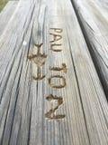 Pisać słowa w drewno stole Fotografia Stock