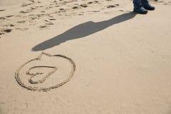 Pisać w piasku na plaży Zdjęcie Stock