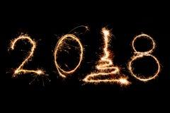 2018 pisać z błyskotanie fajerwerkiem na czarnym tle, szczęśliwy ne Fotografia Stock