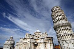 Pisa. Piazza del Duomo (Piazza dei Miracoli) with famous landmarks of Pisa - Duomo cathedral, leaning tower and baptistery. It is UNESCO World Heritage Site Stock Photography