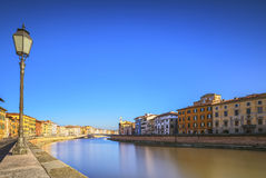 Pisa, Arno river, lamp and buildings reflection. Lungarno view. Royalty Free Stock Photo