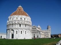 Pisa Baptistery and Leaning Tower. Pisa Baptistery in front of the Cathedral and leaning tower in Pisa Italy Stock Image
