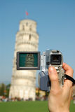 Pisa camera. Tourist shooting video of the famous leaning tower of pisa italy Stock Photography