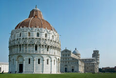 Pisa, Cathedral and Leaning Tower. Baptistry, Pisa, Italy, with the Cathedral and Leaning Tower. Square photo with the famous leaning tower of Pisa Stock Photos