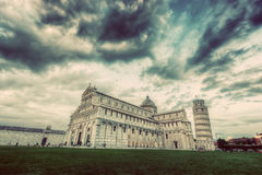 Pisa Cathedral with the Leaning Tower of Pisa, Tuscany, Italy. Vintage Stock Image