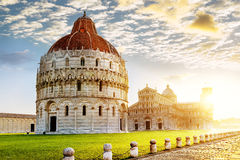 Pisa city. Place of Miracoli complex with the leaning tower of Pisa in front, Italy Royalty Free Stock Photos